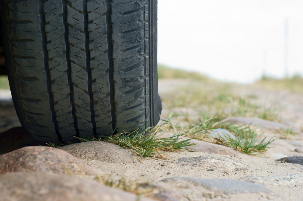 tire on road of stone